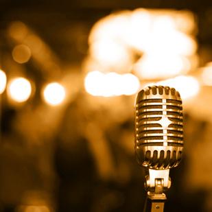 bigstock_Retro_microphone_on_stage_19458830